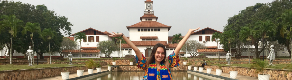Picture of student in front of the University of Ghana's Balme Library